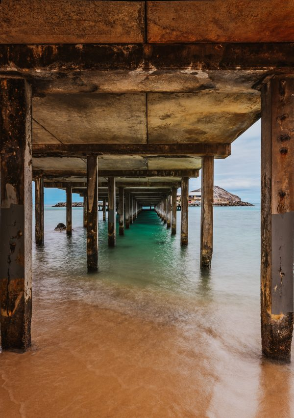 vivid bright colors long exposure under pier fine art