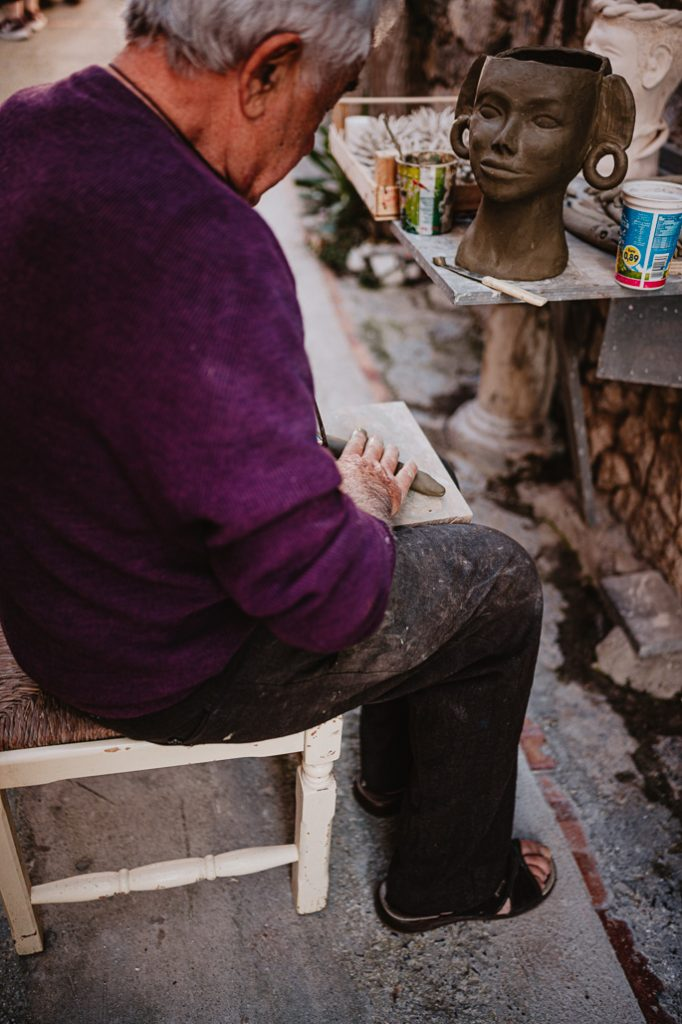 artist creating art in italy